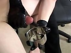 a blond girl giving handjob with her new gloves