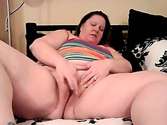 mature bbw plays with her big tits and plump pussy
