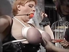 Dominatrix Punishes Her Slaves Tits